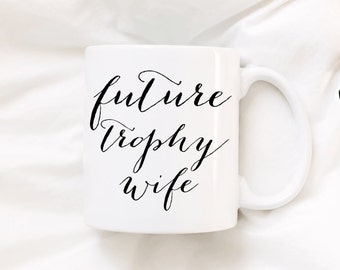 Future Trophy Wife. Coffee mug. We're engaged. Engagement ring. Engaged. Fiance. Feyonce