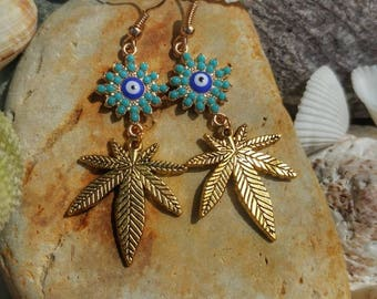 Turquoise accented Third Eye Cannabis Leaf Earrings.