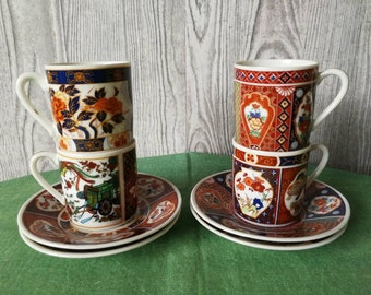 4 Small cups and saucers