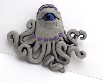 Ocho the octo brooch by Marie Segal 2008 from a series of EyeDollz