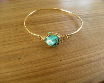Bracelet... Bangle Bracelet hammered brass with a wire wrapped turquoise stone.