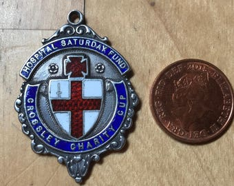 1904 silver pendant . Beddington Corner FC winners . Crossley charity cup. Hospital Saturday Fund. Very good condition . Size ca 35x30mm