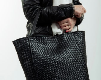 Hand braided leather bag in Italy