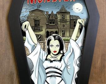 Lily Munster coffin framed print.