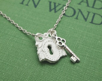 shabby chic keyhole necklace. vintaged white wood keyhole with small silver key charm