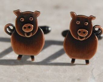 Pig cufflinks in copper finish