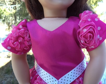 18 inch bright pink doll gown, pink short sleeved gown, pink dotted lace overlayed gown, matching pink shoes with gown, dotted ribbon