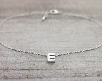 Custom upper case initial silver bracelet with an adjustable extension chain