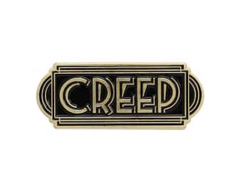 Creep black and gold enamel lapel pin