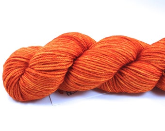 Tangerine Speedo--hand dyed worsted weight, merino superwash (218yds/100gm)