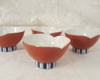Vintage set of four rice bowls with gold trim marked Japan on bottom