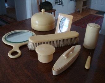 Nine piece celluloid (French Ivory) dresser set