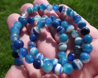 6 BLUE LACE AGATE 8 MM ONYX BEADS.
