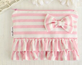 Pink and white zipper pouch with ruffles and bow