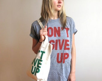 Don't Give Up Unisex