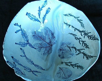 Hand formed ceramic bowl in blue with real impressed leaf designs and sculptural movement.