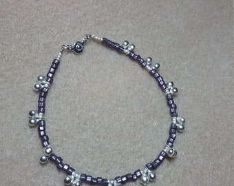 Purple anklet with silver bells