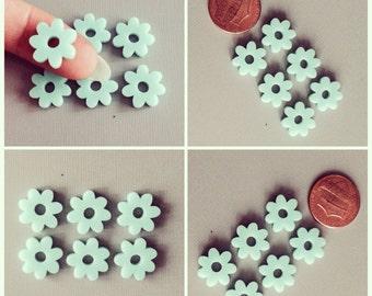 6x laser cut acrylic flower cabochons In light aqua