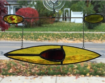 Kayak #1 Stained glass suncatcher hanging from silver steel chain