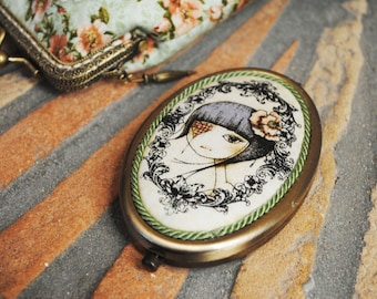 "Vintage Style mirror with a portrait of ""Girl in Patch"" by Santoro Mirabelle."