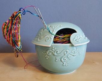 fils de bol avec des rouleaux en Aqua