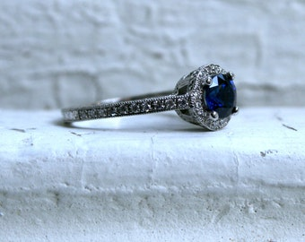 14K White Gold Halo Pave Diamond and Sapphire Ring.