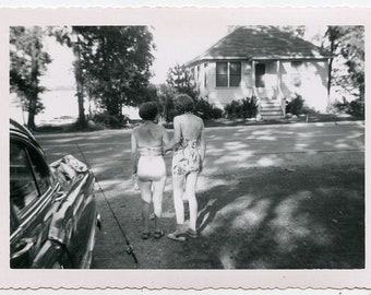 1940s two affectionate women in bathing suits from behind. look away from the camera kodak velox snapshot vernacular photograph photo