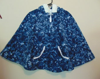 girls size L 10-12  blue Popover Poncho with hood   pullover navy & white hooded poncho with pockets side opening.  size 3-16 available