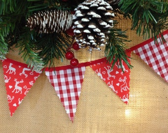 Nordic mini bunting with white stags and gingham attached to red tape, perfect for a traditional Christmas