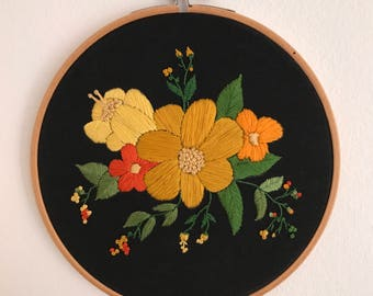 Flowers embroidered on black