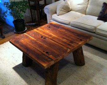 Heart pine rustic coffee table with hand hewn legs