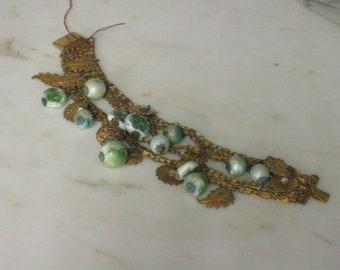 Haskell style multi strand goldtone bracelet & earrings