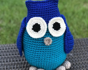 Crocheted owl - made with royal blue, teal blue, gray, white, and black colored acrylic yarn