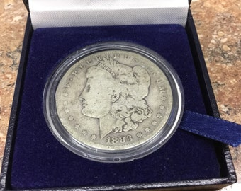 1883 circulated  Morgan silver dollar