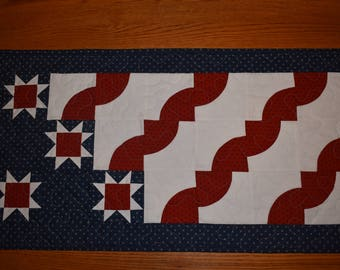 """Patriotic Table Runner with Drunkards Path Blocks and Tiny Sawtooth Stars    32.5"""" long by 16.5"""" wide"""
