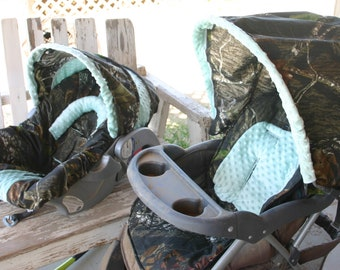 Carseat and stroller not included: mossy oak and aqua car seat COVER and hood COVER with matching stroller hood COVER and seat cushion