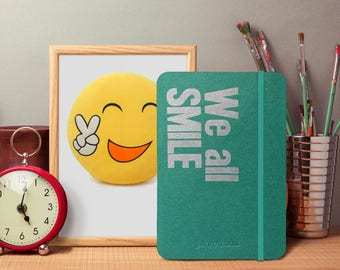 We all SMILE in the SAME language - 100 Page Notebook with quote - Perfect Gift - iPad Mini Size - Fountain Pen Friendly - Bullet Journal