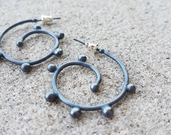 Oxidized sterling hoops with balls