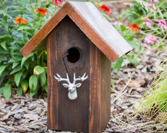 Rustic outdoor birdhouse with rusted metal roof and natural hole