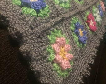 Crocheted colorful flower baby blanket