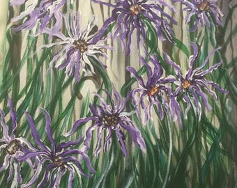 Purple Wildflowers against weathered fence