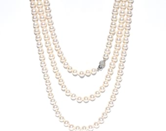 18k Pearl & Diamond Knotted Necklace.