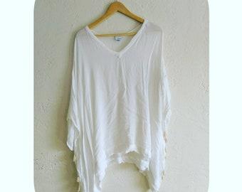 Beautiful medium/large white blouse made in India.