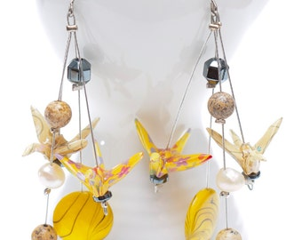 Origami earrings in yellow paper with jasper, pearl, mop and hematite