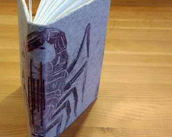 handmade book with original block print cover