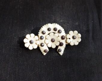 Cute handmade antique celluloid brooch