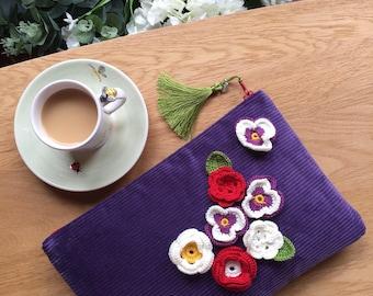 Violet velvet clutch with crochet flowers