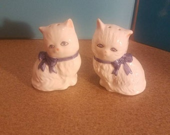 White cats with blue eyes and now ties with pink ears and nose salt and pepper shakers