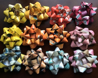 a dozen rainbow colored recycled gift bows