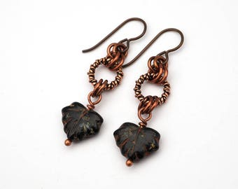 Maple leaf earrings, black and rust glass beads, French hooks, copper dangle